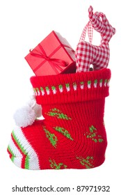 Christmas stocking stuffed with present box and a deer, isolated on white background