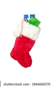 A Christmas stocking with stocking stuffer presents isolated on white.