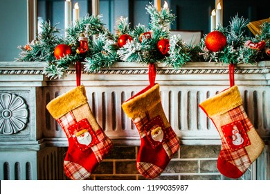 Christmas stockings hanging on the fireplace