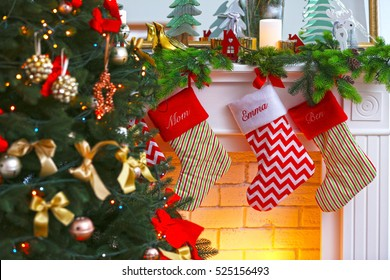 christmas stockings hanging on fireplace near fir tree close up view