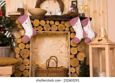 Christmas Stockings Hanging from Rustic Wooden Log Mantlepiece