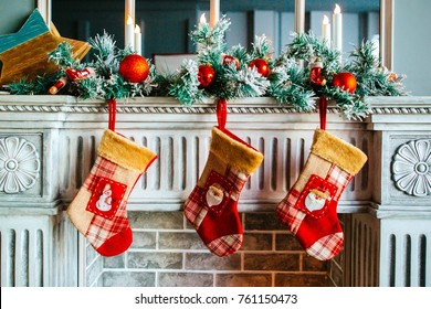 Christmas stockings are on the fireplace