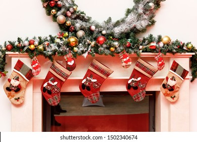 Christmas stockings on a fireplace mantel.