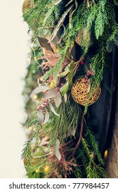Christmas street decoration, fir branches with leaves and ball