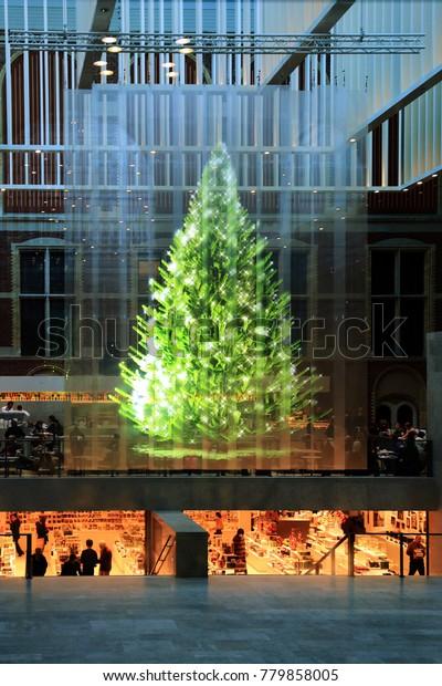 Holographic Christmas Tree.Christmas Street Decorations Hologram Christmas Tree Stock