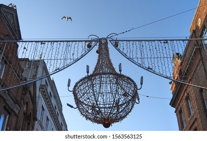 Christmas street globe decoration above Grafton Street in Dublin city centre.