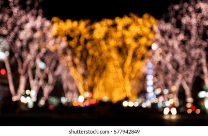 Christmas street light background. Abstract Festive lights. Elegant texture with blurred de focused lights