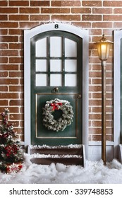 Christmas street studio interior background with door, brick wall, street light and snow
