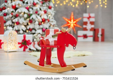 Christmas studio decorations wonderful idea mainly white and red New Year tree with snow and plenty presents under Amazing LED lights bake and huge paper star