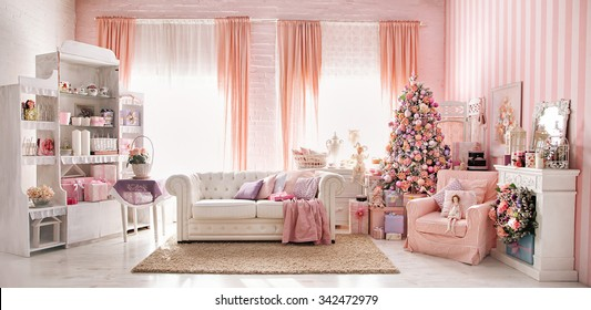 Christmas studio room interior made in pink tones.