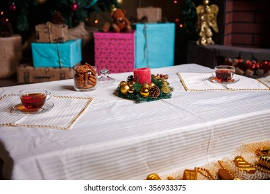 christmas stuff. shot made with shallow depth of field. selective focus. a cup of tea.