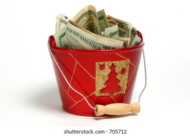 Christmas styled bucket with money.  Donation, giving.
