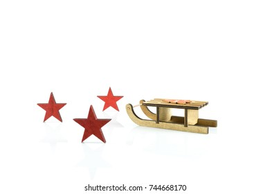 Christmas subject, a sleigh with three red stars on a white background