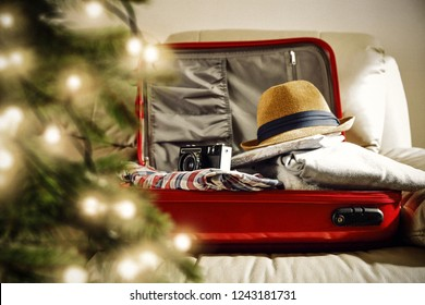 Christmas suitcase and christmas tree decoration.