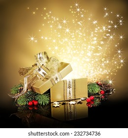 Christmas surprise gift box or present, exploding with glitters and stars against a festive holiday background