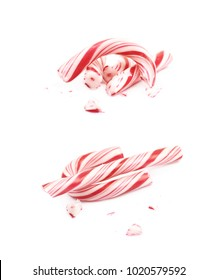 Christmas sweet candy cane, broken into multiple pieces, composition isolated over the white background , set of several different foreshortenings