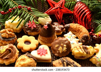 Christmas sweets, cookies, decoration and needles. Linzer sweets, beehives candy.