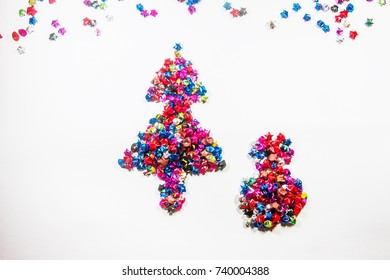 Christmas symbol made of paper stars on a white background.