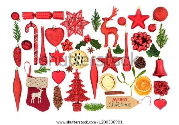 Christmas symbols with tree bauble decorations, winter flora and food items on white background. Festive Christmas card for the holiday season.