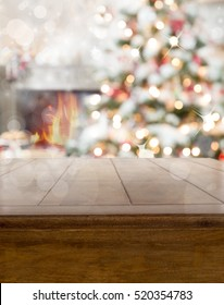 Christmas table background with tree and fireplace, depth of field
