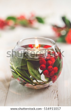 christmas table decoration glass vase with holly berries and white floating candle - How To Decorate Glass Vases For Christmas