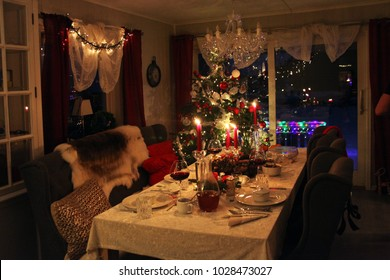 a christmas table on the night in the living room with lights