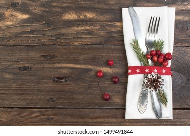 Christmas table place setting. Holidays background. Top view with copy space