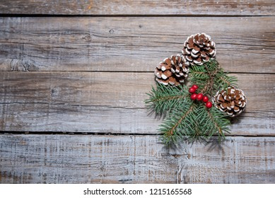 Christmas table place setting with christmas tree branches  and ribbon over wooden table with copy space