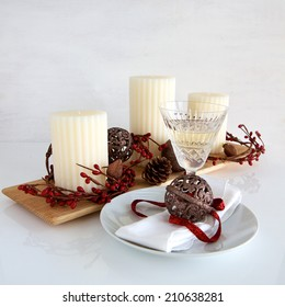 Christmas Table setting with candles and decorations