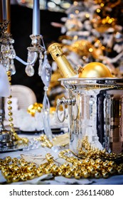 Christmas table setting with champagne and candles