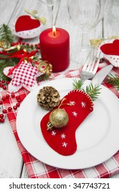Christmas table setting with christmas decorations.