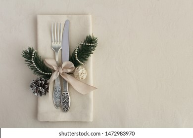 Christmas table setting on the beige  tablecloth. Top view. Copy space.