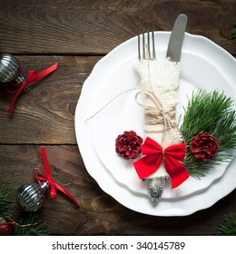 Christmas table setting with christmas pine branches,. Top view