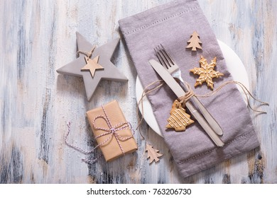 Christmas table setting with christmas star decoration, present box and gingerbread cookie copy space