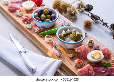 Christmas table with wooden board with food and cakes