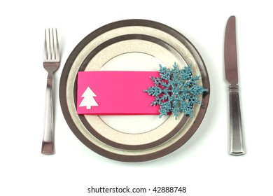 Christmas tableware with pink ornamented card to put congratulations