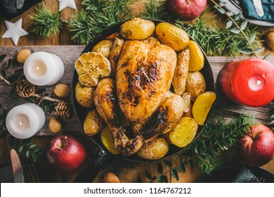 Christmas tasty chicken on pan on dinner table. Concept of christmas dinner. View from above.