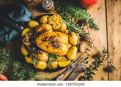 Christmas tasty chicken on pan on dinner table. Concept of christmas dinner. View from above. Horizontal.