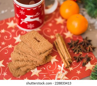 christmas tea with biscuits, cinnamon, anise stars and tangerines