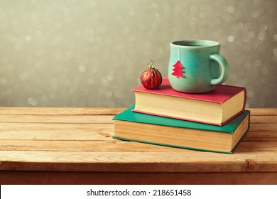 Christmas tea cup and ball on vintage books