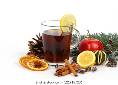 christmas tea or mulled wine - cup of red tea and orange - christmas background