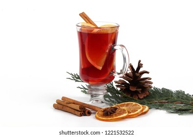 christmas tea or mulled wine - glass cup with a orange and christmas tea or mulled wine