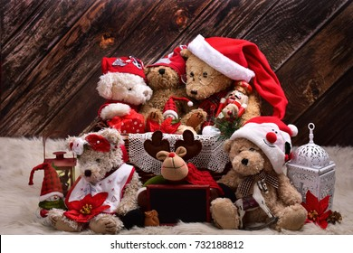 christmas teddy bear family in santa claus outfits with decorations and old toys sitting  on wooden wall  background