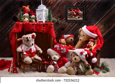 christmas teddy bears in santa claus outfits with old toys in rustic style interior with wooden wall