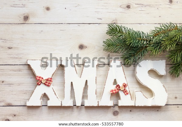 Christmas text and green branches