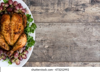 christmas or thanksgiving turkey on rustic wooden background
