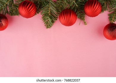 Christmas theme composed with ornaments on pink background. Top view or flat lay