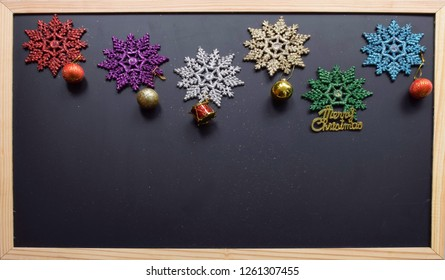 Christmas theme decorate with the colorful sparkling snow flake and round ring on the black board