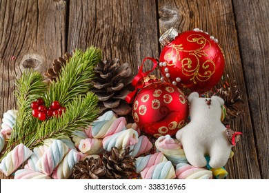 Christmas theme. Pine and red ball on wooden table. Closeup view