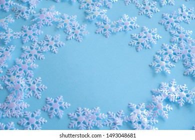 Christmas themed background with lights and white snowflakes